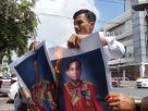 Defiant activist burns pics of PM and Army chief after 3rd police summons